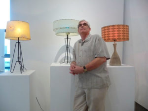 Mark Nielsen poses in front of some of his 1950s lamps.