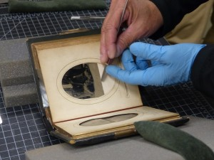 Clements Library conservator Julie Fremuth dismantled the Arabella Chapman albums to retrieve important information such as dates, places, and names written the backs of the photographs. Courtesy The Arabella Chapman Project and the University of Michigan William L. Clements Library.