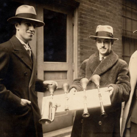 Composer George Gershwin (left) and Cincinnati Symphony Orchestra percussionist James Rosenberg holding four taxi horns used in the orchestra's Feb. 1929 performance of An American in Paris. Photo courtesy of Ira and Leonore Gershwin Trusts.