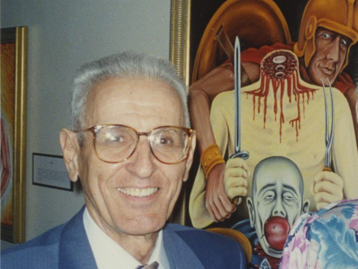 "Photograph of Jack Kevorkian, taken in front of his painting ""The Gourmet (War)"" at Ariana Gallery in Royal Oak, Michigan. Courtesy the University of Michigan Bentley Historical Library."