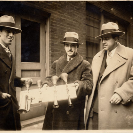 "George Gershwin (left), James Rosenberg, percussionist for Cincinnati Symphony (center), and tenor Richard Crooks (right), pose with taxi horns from ""An American in Paris"" on February 28, 1929. Photo courtesy the Ira & Leonore Gershwin Trusts."