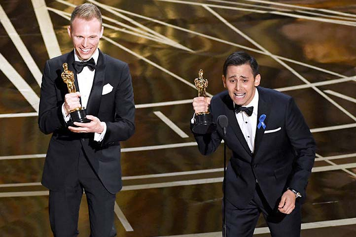 U-M School of Music, Theatre & Dance alums Justin Paul (left) and Benj Pasek (right) just after accepting their Academy Award in the 'Best Original Song' category.