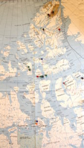 Pins on this map in Taichman's dental school office show some of the 16 Arctic locations he has visited. Although King William Island (the two pins nearest the bottom of the photo) is inside the Arctic Circle, some of Taichman's other trips have taken him much farther north in the remote polar region. Images courtesy: Russell Taichman