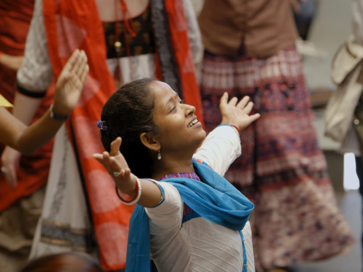 "Jhulan, a dance movement therapist and survivor, dances at Kolkata Sanved's 10th Anniversary Celebration. Credit: ""Little Stones"""