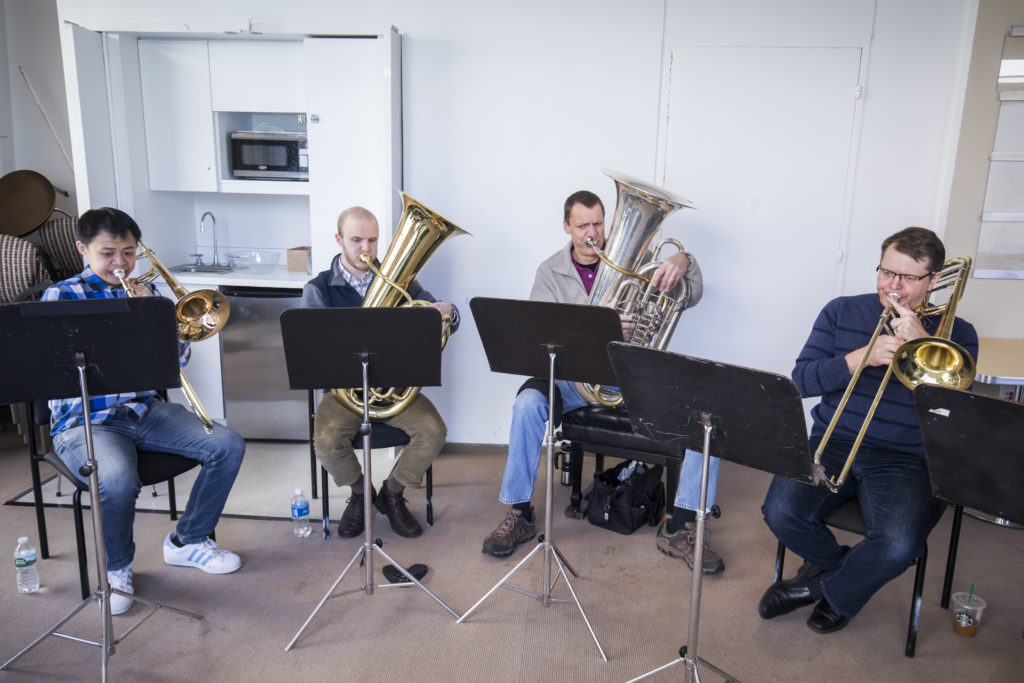 U-M students Zongxi Li and Evan Zegiel rehearses with New York Philharmonic brass members Alan Baer and Colin Williams. Photo by Chris Lee.