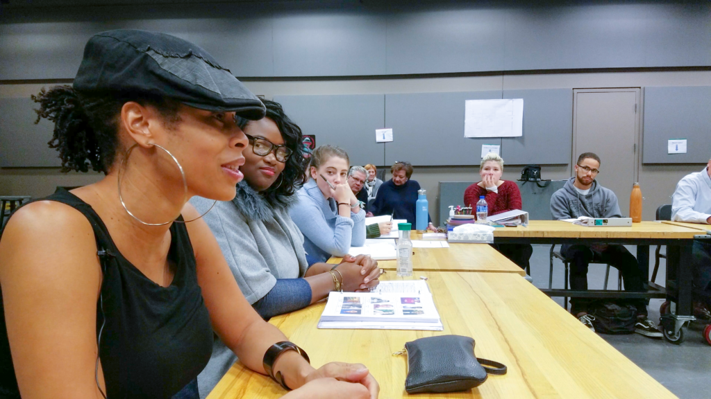 "U-M alumna and playwright Dominique Morisseau (far left) sits next to Stori Ayers, director of ""Blood at the Root,"" during a cast reading at U-M during October 2017."