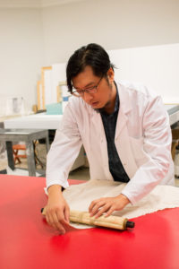 The University of Michigan Museum of Art recently re-opened the Robert B. Jacobs Asian Art Conservation Laboratory under the direction of QianHe (pictured), a fourth-generation art conservator trained in orthodox Chinese Su-style craftsmanship. Photo by Dave Lawrence.