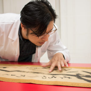 The University of Michigan Museum of Art recently re-opened the Robert B. Jacobs Asian Art Conservation Laboratory under the direction of Qian He (pictured), a fourth-generation art conservator trained in orthodox Chinese Su-style craftsmanship. Photo by Dave Lawrence.