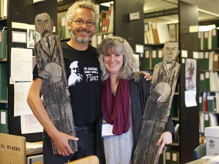 Ari Weinzweig (left), U-M graduate and Zingerman's co-founder, poses with Julie Herrada, curator of the U-M Library Labadie Collection. Photo by Alan Piñon.
