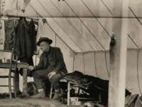 """William B. Mershon """"roughing it"""" during a camping trip. [Family and camping snapshots, 1907-1919. Box 47, Folder 19]. Courtesy the University of Michigan Bentley Historical Library."""