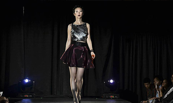 "Molly Ma, wearing clothing designed by fellow student Kyle D'Arcangelo, walks the runway at last year's ""Shameless"" show. The shameless theme encouraged the NOiR community to reject shame about one's interests and racial identity."