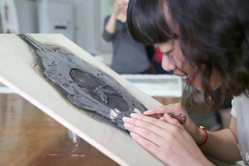 A Stamps student works on a piece of art.