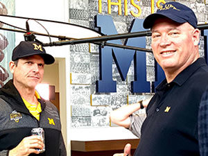 Chace interviews Coach Jim Harbaugh for the film. Image courtesy of Blackpoint West Films.