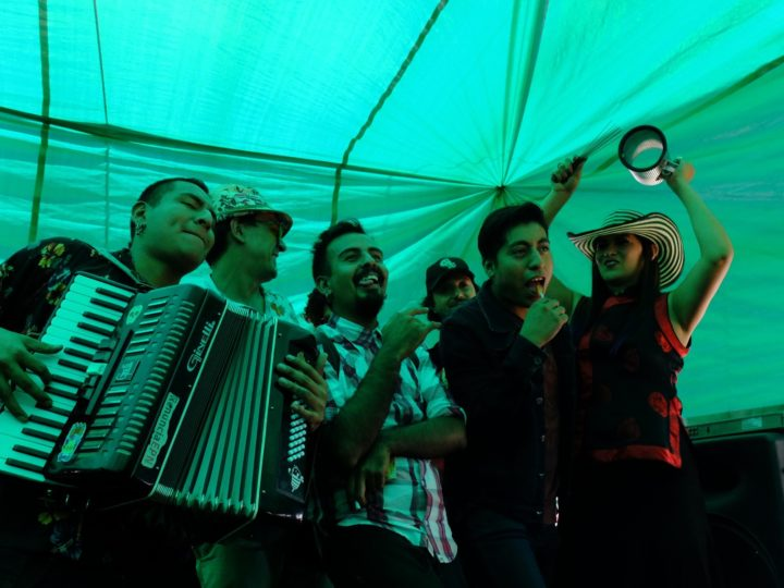 La China Sonidera, a cumbia music band, performs for the audience at Doña Tere's TV shop located in Mercado de Abastos.