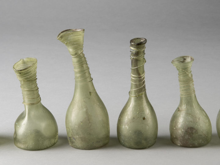 Blown-glass flasks; green glass; Fayoum, Egypt, c. 400–700 CE; Gift of David Askren; University of Michigan Museum of Art