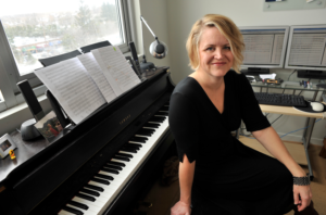 "Kristin Kuster, an associate professor of composition at the U-M School of Music, Theatre & Dance was commissioned to write the new ""Michigan Song."""