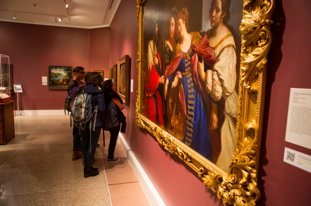 Students browse the European gallery at the U-M Museum of Art; Photo by Jakob Skogheim.