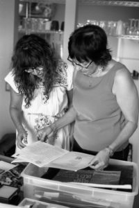 Maria Cotera (left) and Nancy De Los Santos processing the photos after an interview for Chicana por mi Raza Project in Los Angeles, 2014. Photo by Ernesto Chavez.