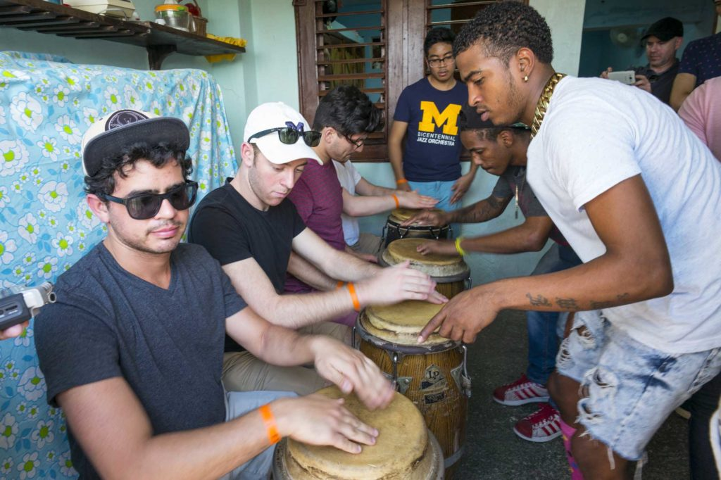 Students (seated) being taught by members of Los Muñequitos de Matanzas