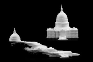 On the bottom, excess vibrations from the 3-D printer caused the printhead to offset multiple times. On the top, the new U-M algorithm was applied to the printer, enabling a successful, fast print. Both U.S. Capitol replicas were printed on a HICTOP Prusa i3 3-D printer at ~2X speed. Photo: Evan Dougherty, Michigan Engineering