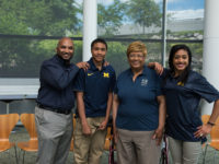 Laurita Thomas, Associate Vice President for Human Resources at U-M, spoke with her son Lemar Thomas for her StoryCorps interview. From left: Lemar Thomas, Islam (grandson), Laurita Thomas, Ava (granddaughter). Photo by Austin Thomason, Michigan Photography.