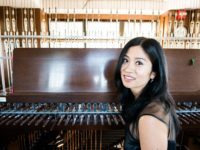 Tiffany Ng, university carillonist and assistant professor of carillon at the University of Michigan School of Music, Theatre & Dance, before playing the carillon at the Burton Tower. Photo by Michael Pihulic.
