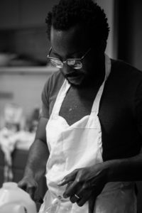 "Photos of Tunde Wey during his pop-up dinner series ""Blackness in America."" Photos by Moyo Oyelola; Courtesy Tunde Wey."