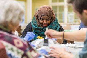Sakinah Rahman works with residents of The Memory Support Center at Brecon Village to create a public art installation centering on light. (Photo by Scott C. Soderberg, Michigan Photography)