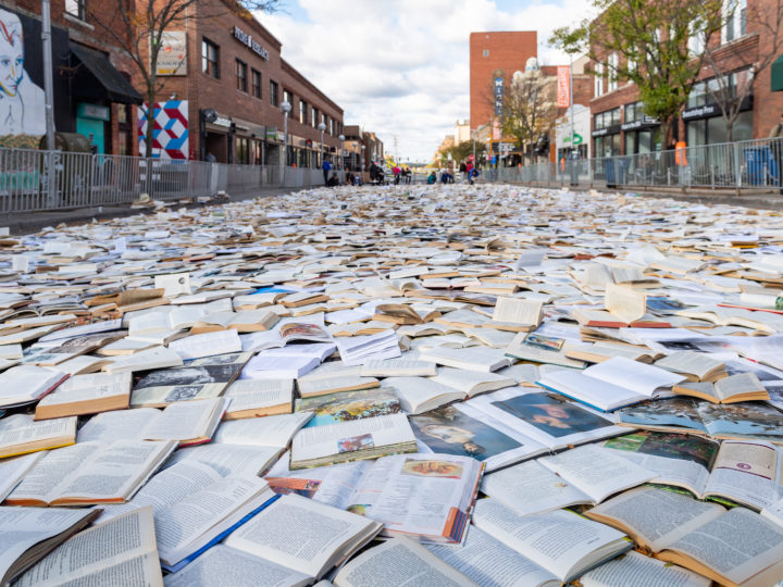 "Luzinterruptus worked with the U-M Institute for the Humanities to ""pave"" Ann Arbor's Liberty Street with 10,000 books. Photo by Scott Soderberg, Michigan Photography."
