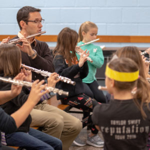 Kellie and Joe McInchak, husband and wife and U-M grads, lead the 5th grade band at Tecumseh Public Schools in Tecumseh, Mich., on Oct. 24, 2018. Photo by Roger Hart, Michigan Photography.