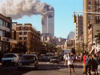 Photo of smoke coming out of twin towers after airplanes crashed into them on Sept. 11, 2001. Photo by David Turnley.