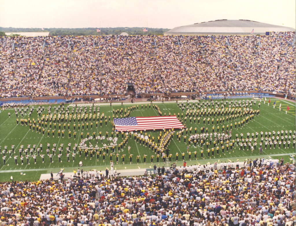 The Michigan Marching Band and the Western Michigan University Marching band stand in formation during the September 22, 2001 halftime show to honor victims of the 9/11 terror attacks.
