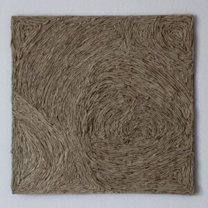 A 12x12 square created of rolled up brown napkins. Glued to a board to create line patterns.