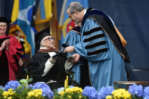 Penny W. Stamps receives an honorary degree from president Mark Schlissel during commencement. Photo by Melanie Maxwell, MLive.