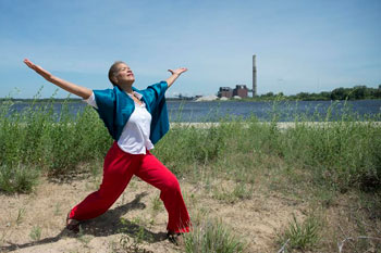 Robin Wilson, associate professor of dance, U-M School of Music, Theatre & Dance, runs through her solo for the upcoming Into the Wind performance on Muskegon Lake.