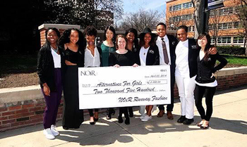 After a successful 2014 show, NOiR executive board members present a check for $2,500 to Alternatives for Girls, an organization that supports homeless and at-risk young women.